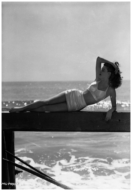 Actress Ava Gardner (1922 - 1990) lounges on a wooden jetty on the beach, wearing an elegant bikini. March 1943 (Photo by Eric Carpenter:John Kobal Foundation:Getty Images)