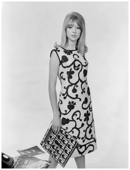 Patti Boyd in a sleeveless, floral print dress she's wearing Brilkie the photograph was made in 1964. Yes, the Beatles album A Hard Day's Night was in the hands of Chaloner Woods - Euro Press - Getty