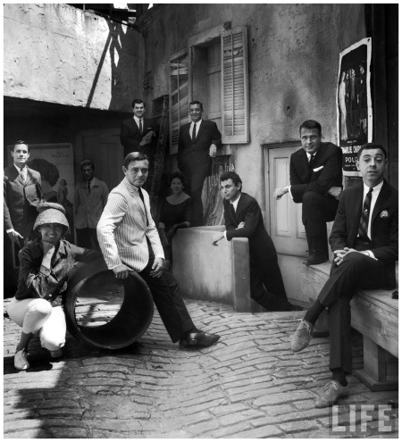 Fashion designers on 20th Century Fox back lot Werle (on ladder in rear), Bud Kilpatrick (poor, rear, in sweater), Travilla (C, standing up high), Bill Pierson (L), James Galanos (R), Helen Rose (poor, rear, in shadow) Photo Gordon Parks 1959