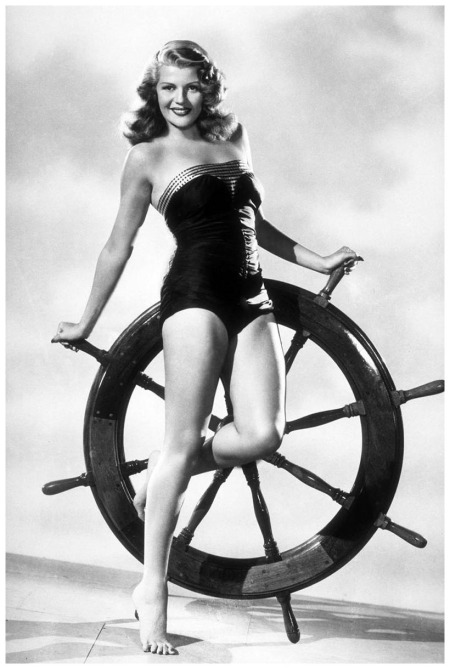Rita Hayworth and Ship's Wheel 1947