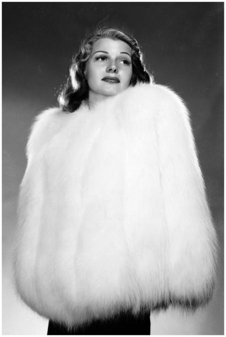 Rita Hayworth encased in a fur jacket. (Photo by A. L. Whitey Schafer:John Kobal Foundation:Getty Images) 1941