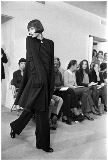 Angelica Huston models a tent coat, blouse and pants from the Halston 1973 Pierre Schermann Corbis