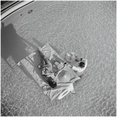 Austrian actress Mara Lane enjoys waiter service in the pool at the Sands Hotel, Las Vegas, 1954