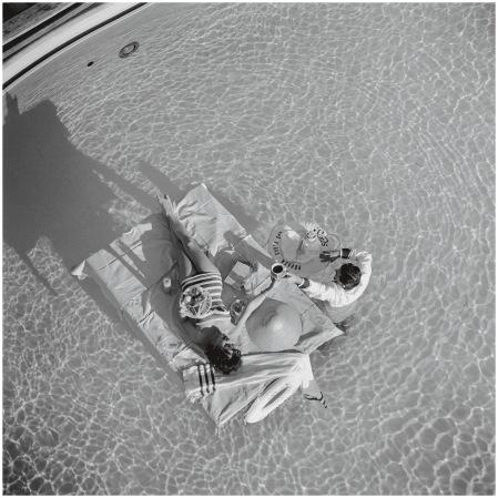 Austrian actress Mara Lane enjoys waiter service in the pool at the Sands Hotel, Las Vegas, 1954