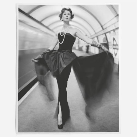 Barbara Goalen in an evening dress in the underground, 1960 Photo John French
