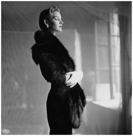 "Model wearing fur stole with hat and white gloves ""More Taste Than Money"" Photo Frances McLaughlin-Gill, Vogue, October 1, 1949 - Photo Frances McLaughlin-Gill"