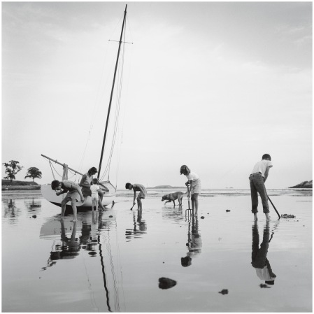 Mrs Hans Estin watches her children digging for clams at low tide on Black Beach, Massachusetts Bay, 1960