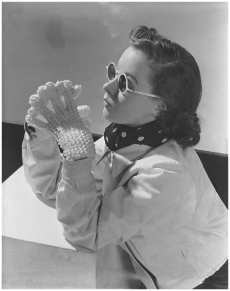Photo Lusha Nelson White frames Model wearing reversible parka-cloth and wool gabardine jacket, sunglasses, and Lanz of Salzburg knit gloves in 1937 Condè Nast Archive