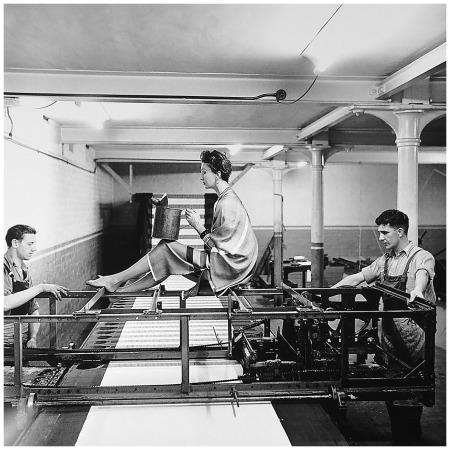 Elsbeth Juda, Barbara Goalen on printing machine, Lancashire, 1952