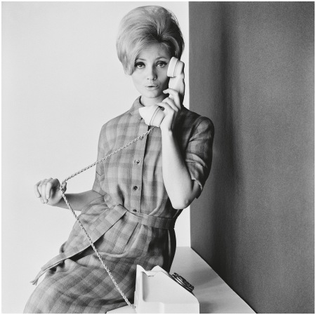 Lady on the telephone in a belted checked dress, 1960s - Photo John French