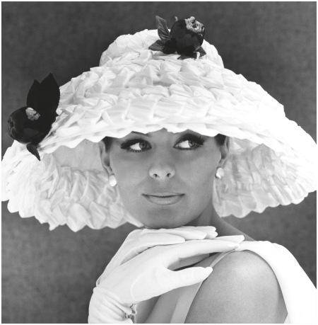Model wearing wide brimmed hat with flowers, 1950s - Photo John French