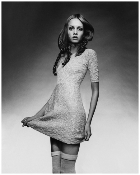 Twiggy wearing a knit baby-doll dress with ribbed bodice by Juliano Knits, with thigh- high socks, a choker by Mary Smith, and braids by Edith Imre. Circa April 1970 Justin de Villeneuve, Vogue, April 15, 1970