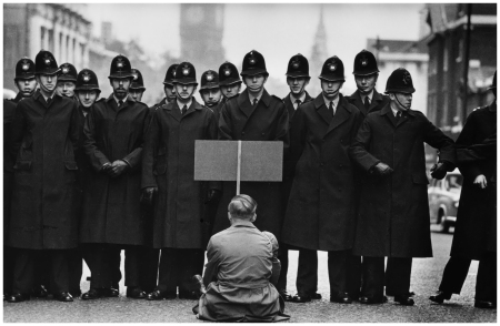 A lone anti-war protester confronts police in Whitehall, London, during the Cuban Missile Crisis, London, 1962 Don McCullin is a war photographer who travelled all over the world to document the wars and crisis'