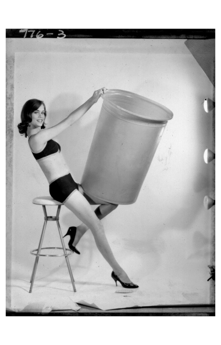 Lauren Hutton playfully put a trash can over her head Photo Norman Nathan 1962 b