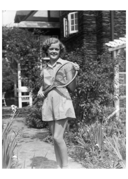 Teen Girl Brunette on Sidewalk of House Holding Tennis Racket Wearing Shorts 1938 b