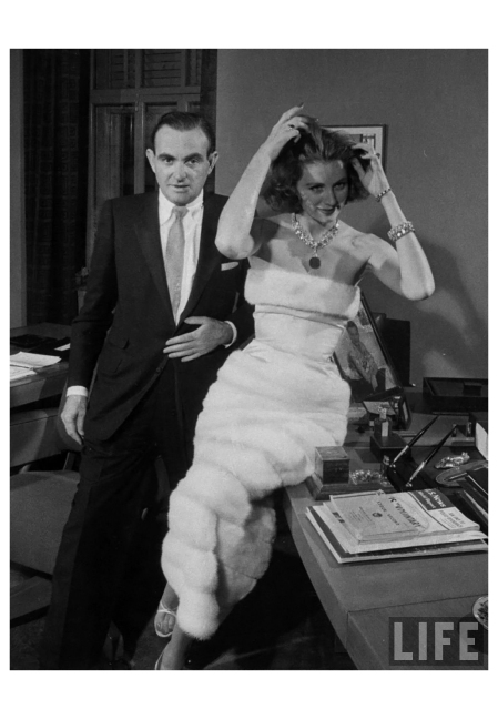 Fashion model, Suzy Parker (R) posing with President of Revlon Co., Charles Revson b
