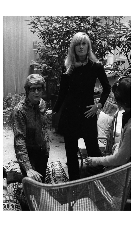 "Yves Saint Laurent met his androgynous alter ego at Régine's night club in 1967. He would describe the tall, willowy blonde as being ""like a twin sister,"" and her lanky proportions would inspire his groundbreaking pantsuits."