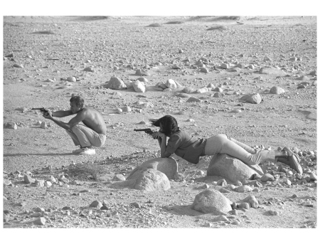 Steve McQueen and Neile Adams, his first wife, target-practice with their pistols in the California desert, 1963.