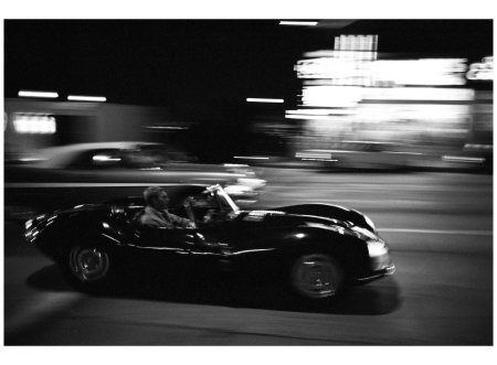 Steve McQueen driving on Sunset Strip, 1963.