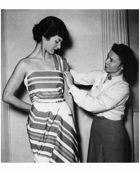 Madame Carven fitting a model in 1950
