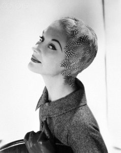 Lisa Fonssagrives-Penn modeling feathered sheath hat by Adolfo for Emme and tweed jacket by Ellen Kaye. Circa September 1954