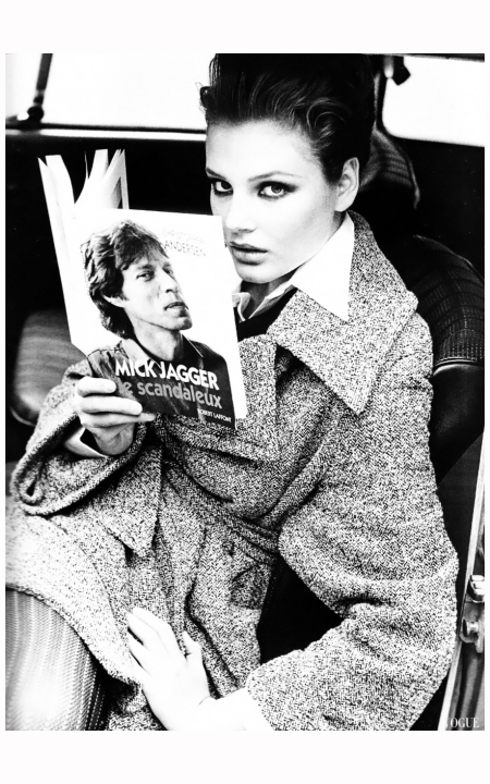 "Bridget Hall reading Mick Jagger le scandaleux by Christopher Andersen in ""La Rue Des Petits Manteaux"" in Vogue Paris, August 1994. Photographer Pamela Hanson."