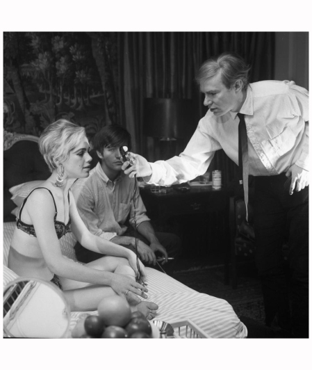 Edie Sedgwick was cast in several of Andy Warhol's underground films that made her a household name. In this photo, Warhol checked the lighting on the set of the 1965 film %22Beauty No. 2.%22