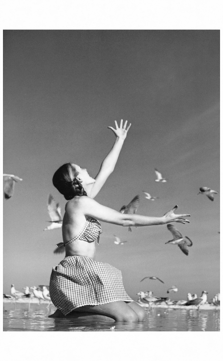 Model is wearing bathingsuit by Youngthings, photo by Avedon, Daytona Beach, Florida, March 1946