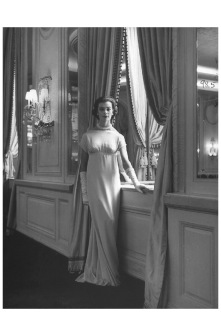 A model wearing a exaggerate silhouette of silk dress, designed by Charles James 1956 Photo Nina Leen