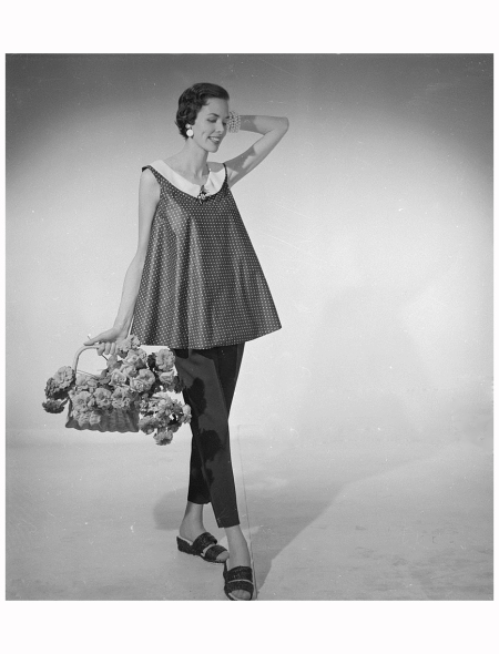 A woman modelling a flared sleeveless top with leggings and sandals 1954 Photo Chaloner Wood