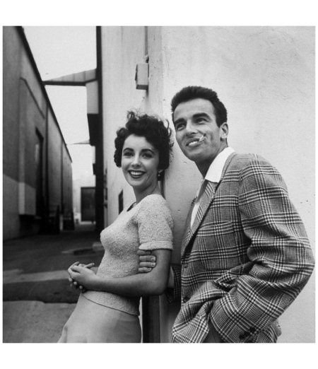 Elizabeth Taylor and Montgomery Clift posing together outside at Paramount Studios during break in filming %22A Place in the Sun 1950 Photo Peter Stackpole
