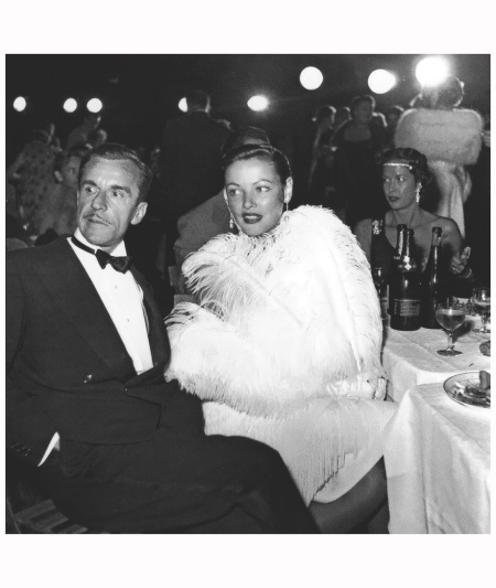 Howard Hughes and Gene Tierney at Jacques Fath's %22Hollywood 1925%22 costume ball, photo by Willy Maywald, 1951