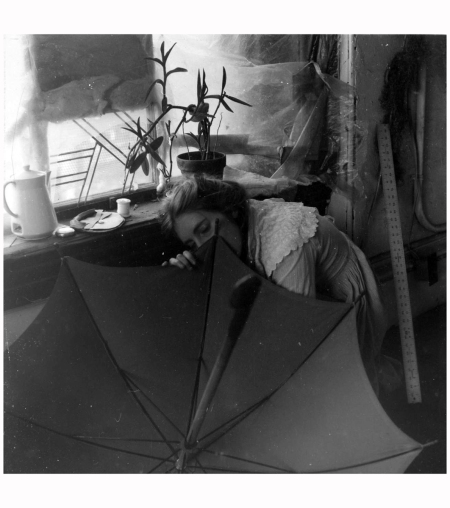 Untitled (FW crouching behind umbrella) circa 1980 by Francesca Woodman 1958-1981