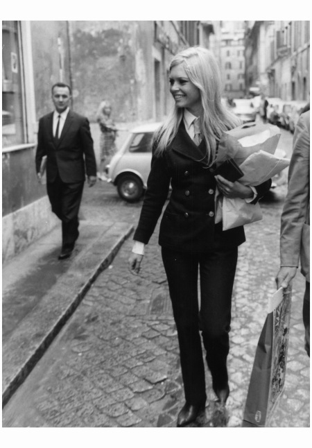 Brigitte Bardot goes shopping in the Via Margutta in Rome wearing a sleek trouser suit Chanel 1967 Keystone