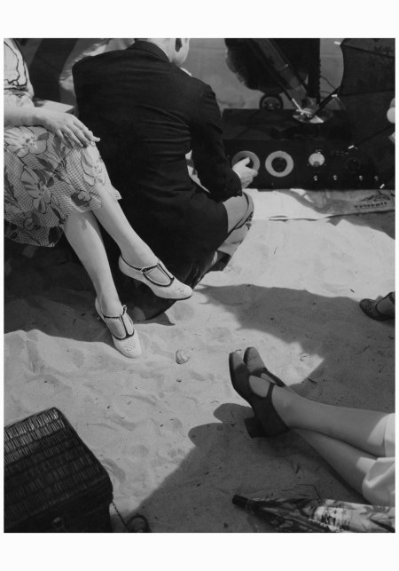 In a scene shot by Edward Steichen for Vogue (April 1925), a metropolitan crowd seemingly decamps to the shore (on Long Island, perhaps?) and a beachside bash unfolds