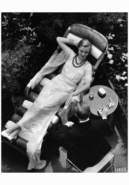 Lush gardens frame a photograph featured in Vogue (August 1932); the models, highballs in hand, could pass for East Egg gentry