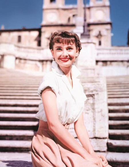 Audrey Hepburn on the Spanish steps in front of Trinita dei Monti church, while filming Roman Holiday.